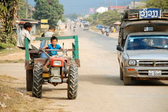 Laos child ride tractor Royalty Free Stock Photos