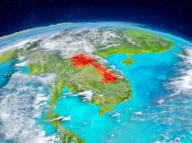 Laos on Earth. Orbit view of Laos highlighted in red on planet Earth with highly detailed surface textures. 3D illustration. Elements of this image furnished by Royalty Free Stock Image