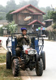 Laos farmer drive Tractor. LUANGPRABANG,LAOS-JANUARY 2008:Unidentified Laos farmer drive Tractor  in road near louangphabang province.Laos is Country in AEC Royalty Free Stock Photography