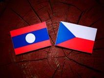 Laos flag with Czech flag on a tree stump  Royalty Free Stock Photos