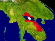 Laos with flag on Earth Stock Image