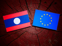 Laos flag with EU flag on a tree stump isolated Royalty Free Stock Image