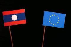 Laos flag with European Union EU flag  on black Stock Photos