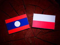 Laos flag with Polish flag on a tree stump isolated. Laos flag with Polish flag on a tree stump stock illustration
