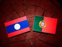 Laos flag with Portuguese flag on a tree stump isolated. Laos flag with Portuguese flag on a tree stump vector illustration