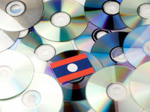 Laos flag on top of CD and DVD pile isolated on white Royalty Free Stock Photography