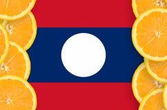 Laos flagga i vertikal ram för citrusfruktskivor fotografering för bildbyråer
