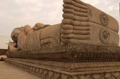 Laos: The Giant lying buddah statue in Vientiane. Laos: The Giant lying buddah statue in the capital Vientiane next to the holy stupa Royalty Free Stock Images