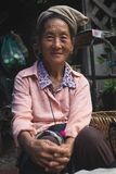 Laos local elder smiling to the camera royalty free stock photo