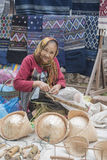 LAOS LUANG PRABANG OLD TOWN MARKET HANDWORK. A women at basket handwork in the town of Luang Prabang in the north of Laos in Southeastasia Royalty Free Stock Photo