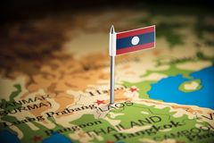 Laos marked with a flag on the map.  royalty free stock images