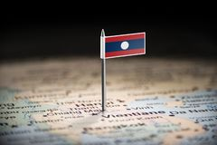 Laos marked with a flag on the map.  stock image