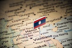 Laos marked with a flag on the map.  stock images