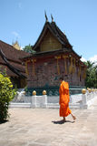 Laos Monk. Monk walking by a temple in Luang Prabang, Laos Stock Image