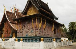 Laos: Monks are restoring the monastry Vat Xieng Thong in Luang royalty free stock images
