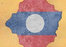 Laos rachou o furo e bandeira quebrada na fachada material concreta grande Foto de Stock Royalty Free