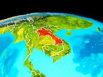 Laos in red. Satellite view of Laos highlighted in red on planet Earth with borderlines. 3D illustration. Elements of this image furnished by NASA Royalty Free Stock Photography