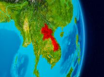 Laos from space. Country of Laos in red on planet Earth. 3D illustration. Elements of this image furnished by NASA Royalty Free Stock Images