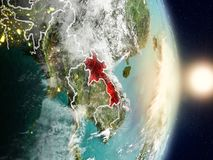 Laos during sunrise. Highlighted in red on planet Earth with visible country borders. 3D illustration. Elements of this image furnished by NASA Stock Photo