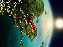Laos during sunrise. Highlighted in red on planet Earth with visible country borders. 3D illustration. Elements of this image furnished by NASA Stock Image
