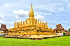 Laos travel landmark, golden pagoda wat Phra That Luang in Vientiane. Buddhist temple. Famous tourist destination in Asia. Stock Photo