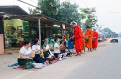 The monks of Laos. In Laos, where all people believe in Buddhism, a man must experience being a monk once in his life. Monks are a socially respected occupation Royalty Free Stock Photography