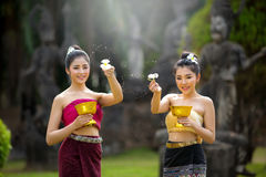 Laos girls splashing water durin tradition festival Laos Vientiane, Songkran festival 2017 royalty free stock photography
