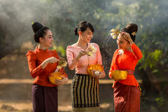 Laos girls splashing water durin tradition festival Songkran festival royalty free stock images