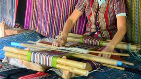 Laos Women weave cloths and sell cloth for show  traveler stock video