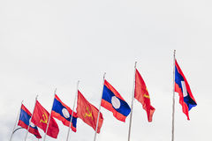 Laos y banderas comunistas Imagen de archivo