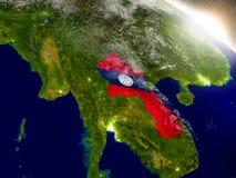 Laos z flaga w powstającym słońcu Obraz Royalty Free