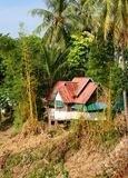 Idyllic ancient Laotian bungalow in the jungle, Laos Royalty Free Stock Image