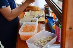 Laotian people cooking Khao Jee Sandwich or Baguette Sandwich Royalty Free Stock Photos