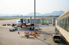 Laotian people loading baggage to store room of plane for flight Royalty Free Stock Image
