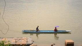 Laotian people rowing wooden boat at mekong river stock video footage