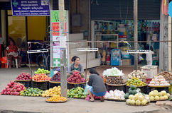 Laotian people sale fruits on street at local night market Stock Image