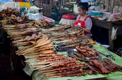 Laotian people sale meat and fish grilled lao style for travelle Stock Image