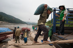 Laotian porters on the Mekong River Royalty Free Stock Image