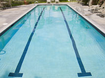 Lap swimming pool. An outdoor lap swimming pool. Wide angle view Stock Photography