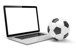 Lap-top και σφαίρα ποδοσφαίρου ποδοσφαίρου σε απευθείας σύνδεση ποδόσφαιρο Στοκ Εικόνα