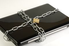 Lap top in chains. Security concept lap top wrapped in chains and padlocked Royalty Free Stock Photos