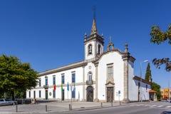Lapa Chapel - a Sacred Art Museum (right), and the Lusiada University branch (left). In Vila Nova de Famalicao, Portugal stock image