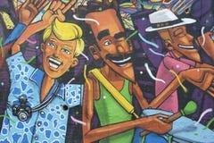 Lapa Rio de Janeiro Brazil Street Art Graffiti. RIO DE JANEIRO, BRAZIL - MARCH 6, 2015: Street art in graffiti depicts happy people celebrating in Lapa, the stock photo