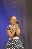 Lapeho Angelina com canção Imagens de Stock