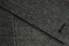 Lapel and pocket of a gray woolen tweed coat Stock Image