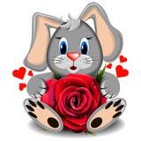 Lapin d'amour de jouet avec la rose réaliste de rouge photos libres de droits