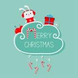 Lapin dans des écouteurs, giftbox, flocon de neige, boule Carte de Joyeux Noël canne de sucrerie s'arrêtante Ligne de tiret avec  Photo stock
