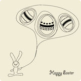 Lapin de dessin animé de Pâques avec des oeufs Images stock