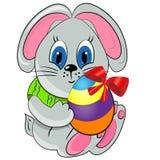 Lapin de Pâques avec l'oeuf paited. Photographie stock libre de droits