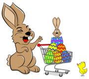 Lapin de Pâques avec le caddie Photo stock
